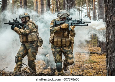 Norwegian Rapid reaction special forces male and female FSK soldiers in field uniforms in action in the forest fog
