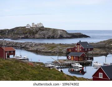 Norwegian rorbu fishing houses and boats on Bjornsund