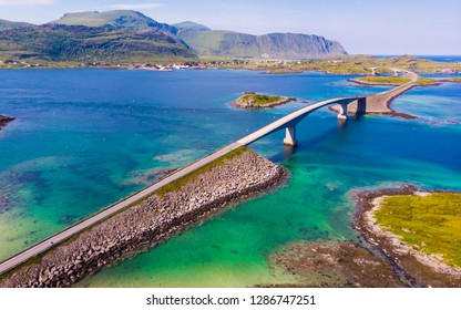 Norwegian scenic landscape on Lofoten archipelago. Road and bridge connecting the islands over the sea. National tourist route 10 Norway. Aerial view