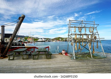 Norwegian traditional stockfish(cod) outdoor drying on the sun above blue sky