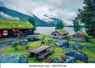 Norwegian typical grass roof wooden old house on the Innerdalsvatna lake. Colorful morning scene in Norway, Europe. Beauty of countryside concept background. Instagram filter toned.