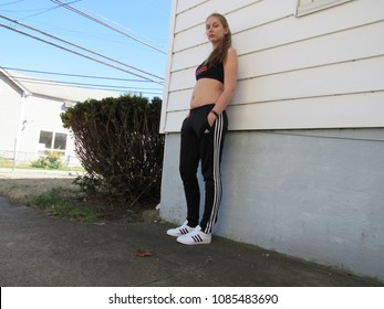 c95a4614 Norwich, Connecticut / USA - April 20 2018: Young woman wearing an entire  Adidas