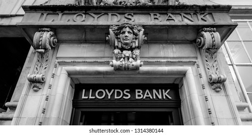 Norwich, England - Feb 13, 2019: Decorated Keystone above Entrance to LLoyds Bank Norwich, Located at 16 Gentelman's Walk, Black and white photography