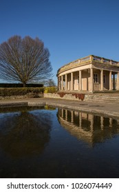 Norwich, Norfolk, England - February 15 2018 : Eaton park bandstand and pavilion reflected in the sunken lily pond