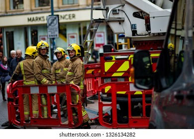 Norwich, Norfolk, England - February 16 2019: A group of firemen having a debrief after an intense training session in the city centre