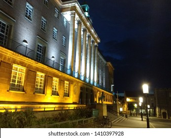 Norwich Norfolk England - May 11 2019: the stunning 1930s Art Deco architecture of the Town Hall overlooking the market place in the centre of the night city lit up in yellow and blue late evening