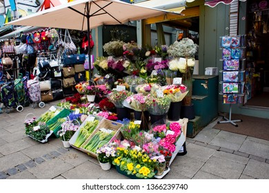 Norwich, Norfolk, UK – April 6 2019: Norwich market stall street vendor selling freshly cut flowers