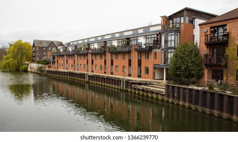 Norwich, Norfolk, UK – April 6 2019: Expensive waterside apartments and penthouses on the quayside of the River Wensum in the city of Norwich, Norfolk