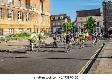 Norwich, Norfolk, UK - June 219 019, Norwich 100 bike ride: Group of cyclists leaving the start of the Norfolk 100 cycle ride heading past the City Hall and out of the city centre