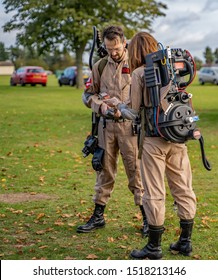 Norwich, Norfolk, UK – September 28 2019. A Caucasian male and female couple dressed up as characters form the Ghost Busters movie at the annual Nor-Con movie and comic convention