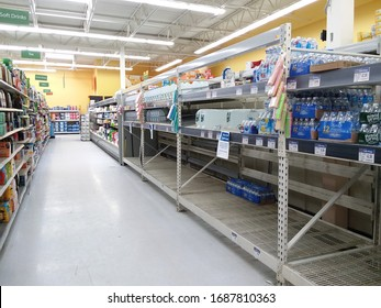 Norwich, NY/US - 3/21/20: Chenango county Walmart shelves nearly empty creating water shortage due to new Coronavirus pandemic & fear of quarantine.