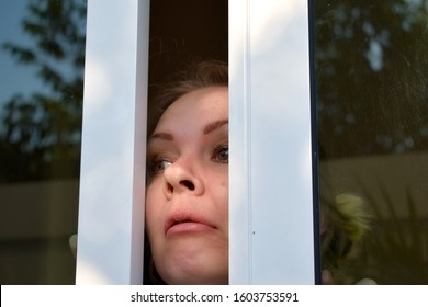Nose in the door. Window pinched nose. Peeking out the window. Clamped the nose of the woman. Face in the glass doors. Face slammed the door. Feminine curiosity. The punishment for curiosity.