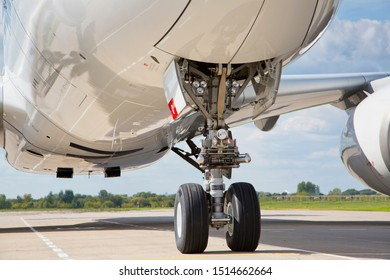 Nose landing gear of a modern passenger plane.  Close-up high detailed view.