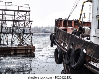 Nose of Tugboat. Winter in harbor. Ice on the water