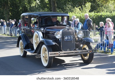 Nostalgia in the country: Old timer cars in a countryside parade during the agricultural festival Flaeijel on September, 2015, the Netherlands