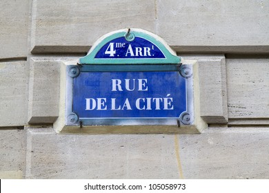 Nostalgic blue sign post in downtown Paris, France