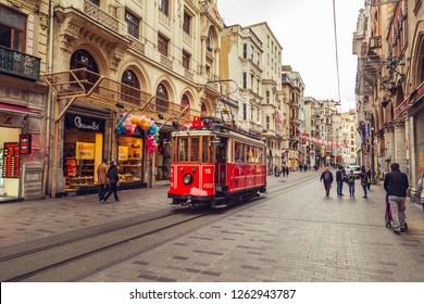 Nostalgic red retro tram on famous Istiklal street. ISTANBUL, TURKEY - NOVEMBER 13, 2018.