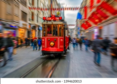 Nostalgic Red Tram in Taksim Istiklal Street at evening. Taksim Istiklal Street is a popular destination in Istanbul. Beyoglu, Taksim, Istanbul. Turkey.