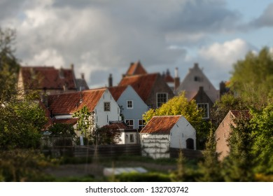 Nostalgic Town in the Netherlands surrounded by bushes.