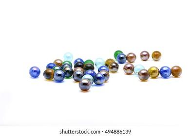 Nostalgic toy: Marbles on white background