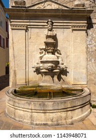Nostradamus bust above the Nostradamus fountain at St Rémy de Provence. Buches du Rhone, Provence, France.