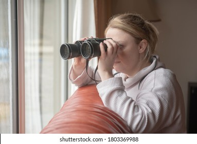 nosy neighbor spying through window with binoculars