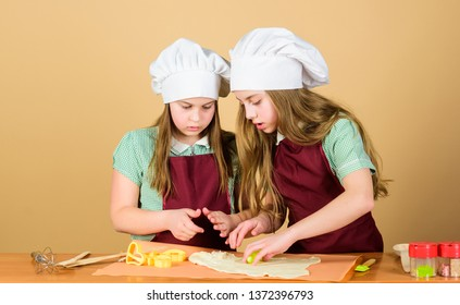 Its not the gods who bake pots. Small children rolling paste to bake pies. Adorable little girls preparing dough in bake shop. Cute kids learning to bake bread.