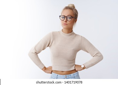 Not impressed. Portrait of unimpressed arrogant good-looking bothered businesswoman hate waste time smirking disappointed and irritated holding hands on waist raising eyebrow doubtful, disbelief