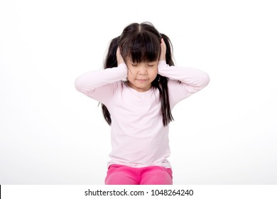 Not listening. stubborn young kid with freckles teasing, covering his closed ears, ignoring his parent scolding with attitude, asking for silence, white background.