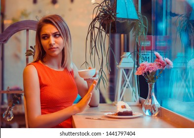 Not for me, no, thank you concept. Closeup Portrait of a young determined fit woman girl refusing to eat chocolate in her home kitchen, near window or in a coffee shop, trendy cafe wearing red dress.