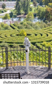 Not occupied tourist binocular on observation deck and view of the maze of bushes, Prague, Czech