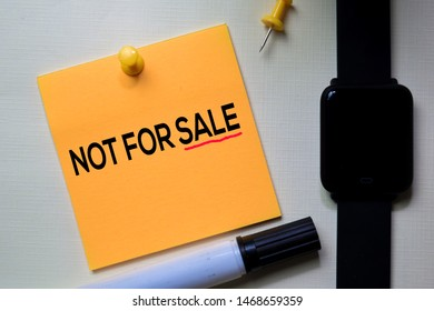 Not For Sale text on sticky notes isolated on office desk