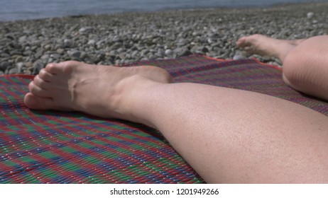 not shaved pubic hair on the thighs of women, natural beauty. girl with unshaven legs and a bikini area in a swimsuit on the beach,