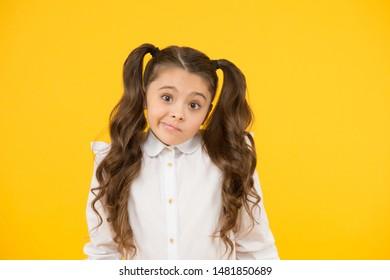 Not sure. Adorable schoolgirl. Schoolgirl pupil long hair cute ponytails hairstyle. Educational program. Homeschooling or visiting regular school. Efficiency studying. Emotional expression schoolgirl.