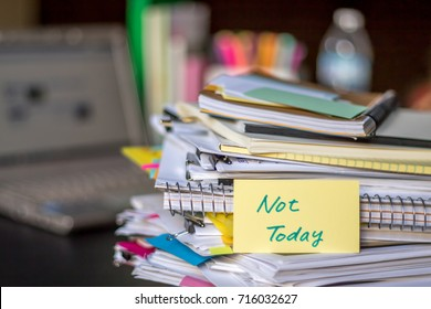 Not Today; Stack of Documents and Laptop at working Desk.