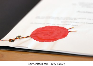 Notarized agreement with red official seal