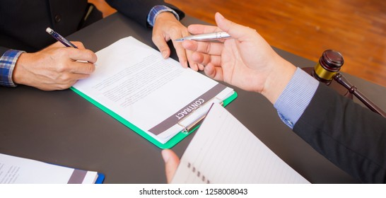 Notary with client in office. Lawyers talk about documents or contract deals. Legal planning. Concepts of law, advice, legal services.
