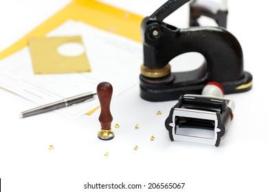 Notary public embosser, stamp, stapler. Selective focus.