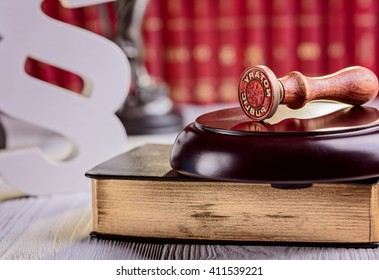 Notary public metal stamper with symbols of law in court library