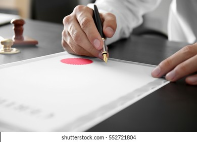Notary public in office signing certificate