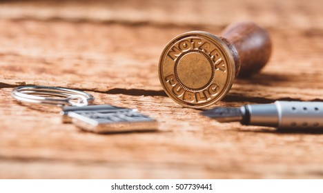 Notary public wax stamper on old wooden background