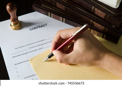 Notary signing a contract with fountain pen. business man law attorney lawyer notary public