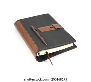 Note book with ballpoint pen on white background