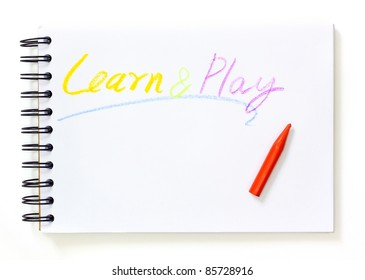 note book with learn and play text over white background