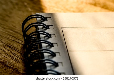 Note book on wood background.