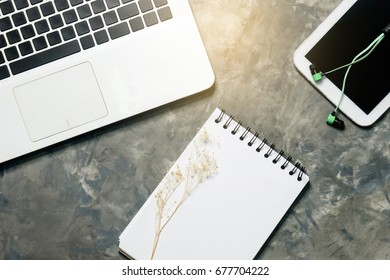 note book paper laptop and tablet with smalltalk on art grey background