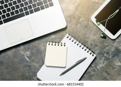 note book paper with pen  laptop and tablet with smalltalk on art grey background