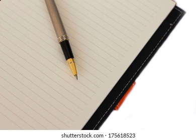note book and pen on background