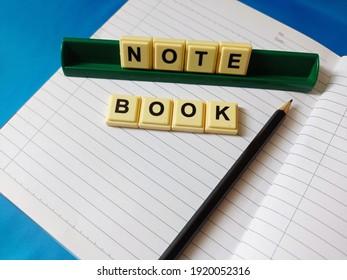 note book ,pencel ,alphabet on blue background