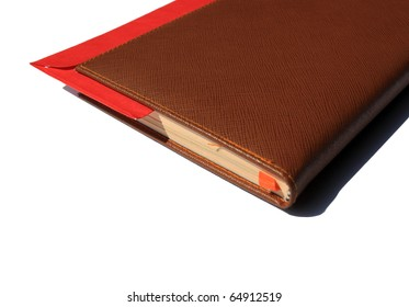 note book with red envelope inside